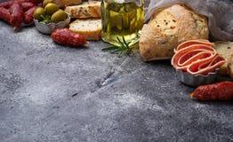 Italian ciabatta bread with olives and salami. Stock Image