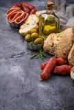 Italian ciabatta bread with olives and salami. Royalty Free Stock Photos