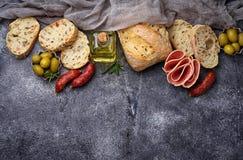 Italian ciabatta bread with olives and salami. Royalty Free Stock Photo
