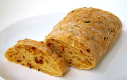 Italian ciabatta with paprika on white plate Royalty Free Stock Image