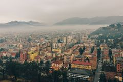 Italian city covered in fog royalty free stock images