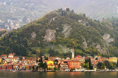 Italian City on the River. View of italian city between the river and the mountains stock photo