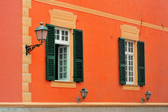Italian classical facade with shuttered windows and lamp Stock Photo