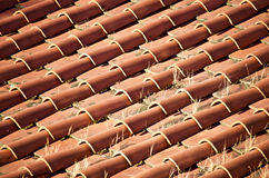 Italian clay roof tile. Old authentic italian clay roof tile on sunny red rooftop. pistoia italy Royalty Free Stock Images