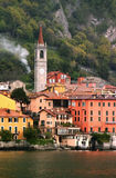 Italian Clocktower. View of clocktower and village by italian riverside Stock Photo