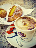 Italian coffee. Cappuccino and pastry Stock Image