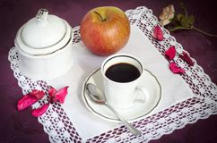 Italian coffee. Cup of black espresso coffee, sugar bowl and an apple on the table Royalty Free Stock Photos