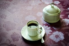 Italian coffee. Cup of black espresso coffee and sugar bowl Stock Image