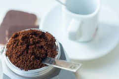 Italian coffee with ground coffee and a cup Stock Photography