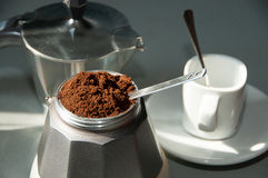 Italian coffee with ground coffee and a cup Royalty Free Stock Images