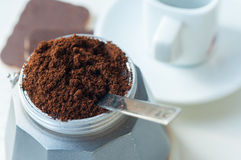 Italian coffee with ground coffee and a cup Royalty Free Stock Photography