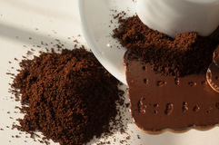 Italian coffee with ground coffee and a cup Stock Image