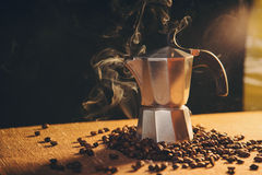 Italian coffee maker and coffee beans Royalty Free Stock Photo