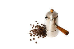 Italian coffee maker and coffee beans. On white background Stock Photography