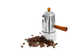Italian coffee maker and coffee beans. On white background Royalty Free Stock Images
