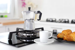 Italian coffee maker and croissants Stock Images