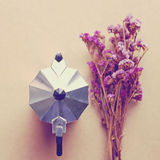 Italian coffee maker and flower with retro filter Royalty Free Stock Image