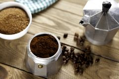 Italian coffee maker with napkin and brown sugar stock photos