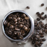 Italian coffee  maker pot filled with coffee beans Royalty Free Stock Photos
