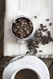 Italian coffee  maker pot filled with coffee beans Stock Image