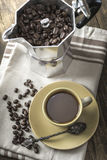 Italian coffee  maker pot filled with coffee beans Royalty Free Stock Photography