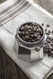 Italian coffee  maker pot filled with coffee beans Stock Images