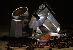 Italian coffee maker unscrewed, ground coffee and whole beans on Royalty Free Stock Photos