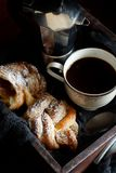Italian coffee set for breakfast. Cup of coffee with croissant on a dark background Royalty Free Stock Photos