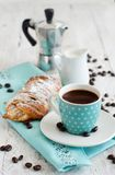 Italian coffee set for breakfast. Cup of coffee with croissant and milk close up Royalty Free Stock Photos