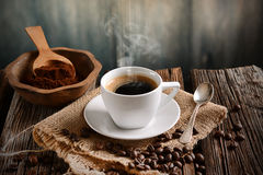 Italian coffee in small white cup. With ingredients around Stock Photos