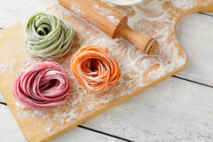 Italian color pasta and rolling pin Stock Image