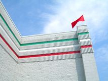 Italian Colored Building. Perspective of an italian themed building with colors and flag Royalty Free Stock Images