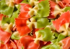 Italian colorful food : italys flag pasta. Italian pasta with the Italian flag colors : red, white and green . Detail of butterfly colored pasta in Italy stock photography