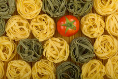 Italian colors pasta with tomato. Italian colors pasta background with tomato Royalty Free Stock Photography