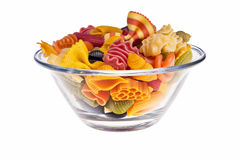 Italian colourful pasta. Italian colourful pasta isolated over white background in transparent bowl Royalty Free Stock Photos