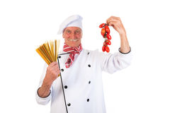 Italian cook with pasta and tomatoes Stock Photography
