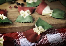 Italian cookery, pasta farfalle. Colours of a flag, photo in vintage style Stock Photo