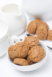 Italian cookies amaretti and crockery for teatime, vertical Stock Images