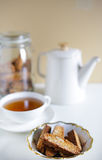 Italian cookies cantuccini biscotti with teapot and tea Royalty Free Stock Images