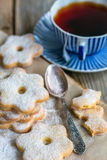 Italian cookies, spoon and a cup of tea. Stock Photos