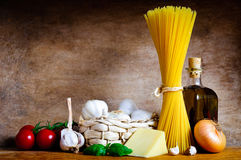 Italian cooking. Healthy italian cooking ingredients for pasta spaghetti on a wooden background Stock Photos