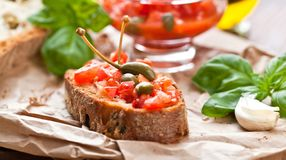 Italian cooking concept. Bruschettas with pesto, tomatoes. royalty free stock images