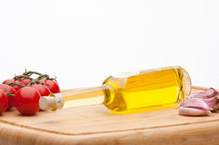 Italian cooking ingredients. A selection of healthy italian cooking ingredients including tomatoes, garlic and olive oil Royalty Free Stock Image