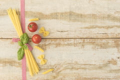 Italian cooking. Ingredients for italian cooking decorated on rustic background with free space for text Royalty Free Stock Images
