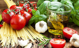 Italian Cooking Ingredients, Spaghetti,Tomates,Olive Oil and Bas. Fresh Mediterranean Ingredients, Cherry Tomatoes, Garlic,Basil, Italian Spaghetti,Olive Oil on Stock Photo
