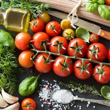 Italian cooking ingridients : cherry tomatoes, herbs, pasta and stock photography