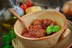 Italian cooking  - meat balls with basil Stock Image