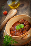 Italian cooking  - meat balls with basil Royalty Free Stock Image