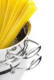 Italian cooking / saucepan with spaghetti. / isolated on white royalty free stock photography