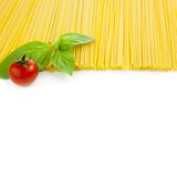 Italian cooking - spaghetti with tomatoes and basil - isolated Stock Photography